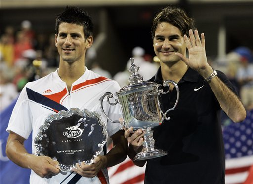 Novak Djokovic, left, of Serbia poses with Roger Federer of Switzerland after Federer won the men's finals at the US Open tennis tournament in New York, Sunday, Sept. 9, 2007.