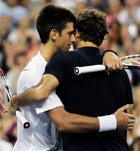Roger Federer, right, of Switzerland hugs Novak Djokovic of Serbia after defeating him in three sets in the men's finals at the US Open tennis tournament in New York, Sunday, Sept. 9, 2007.