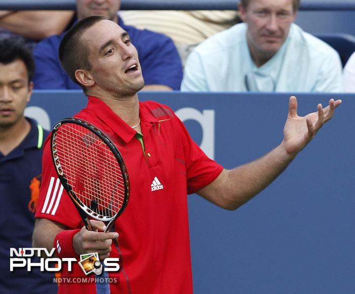Viktor Troicki of Serbia reacts while playing Alejandro Falla of Colombia during the first round of the US Open in New York. (AP Photo)