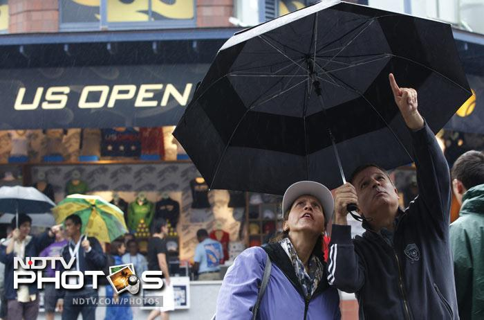 Peter Brown and Claire Canonico look at the players bracket during the US Open tennis tournament in New York. (AP Photo)