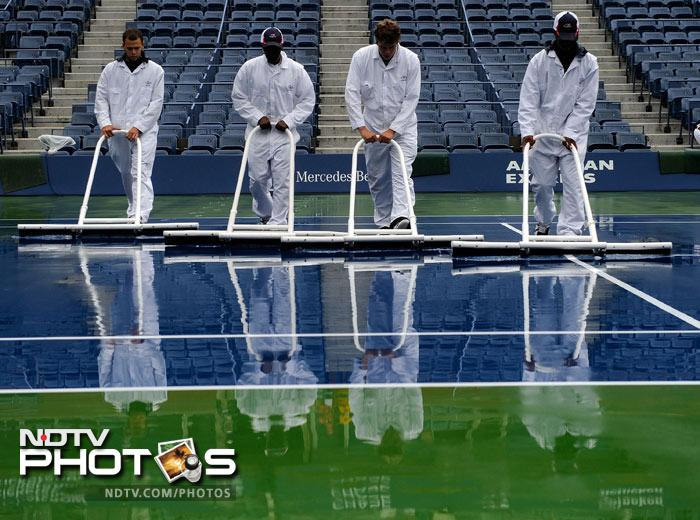 Six men's matches had to be called off only to be followed by a complete washout of the women's draw. A look at the Ashley Ashe Stadium in all it's damp and wet 'glory.'