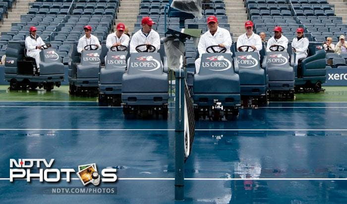 <b>Battle formation:</b> An army of support staff could not do much even with their machines, to keep the water off the hard-courts here.