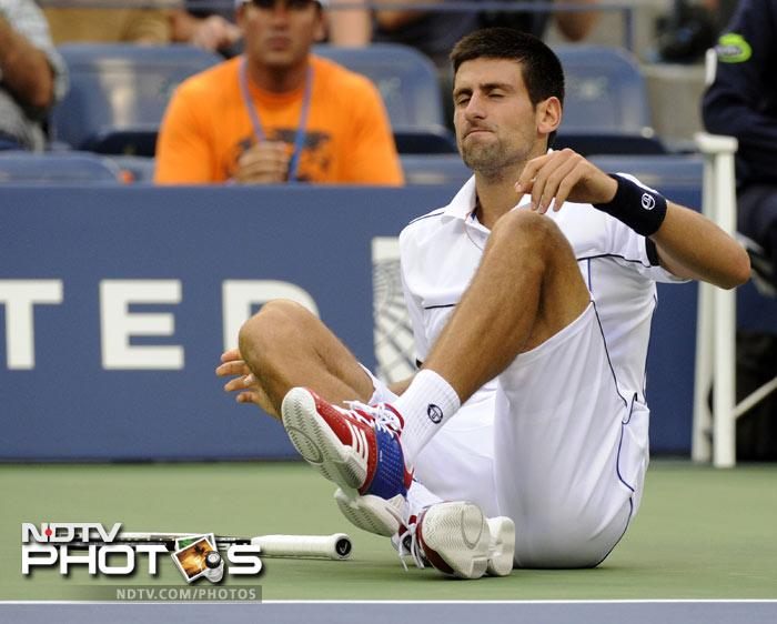 <b>Best seed in action (men's):</b> Novak Djokovic from Serbia (1) sits down on the court and asks for a medical time-out after he celebrated a point against Janko Tipsarevic. (AFP Photo)