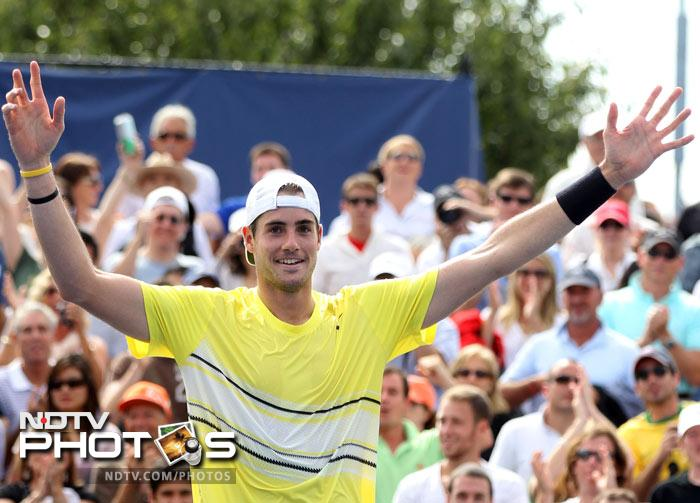 <b>Match of the day: </b>John Isner of the United States reacts after defeating Gilles Simon of France 7-6 (2), 3-6, 7-6 (2), 7-6 (4). (AFP Photo)