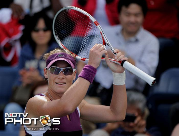 <b>Upset of the day: </b>Number nine Samantha Stosur of Australia celebrates her 6-3, 6-3 win over number two Vera Zvonareva of Russia. (AFP Photo)