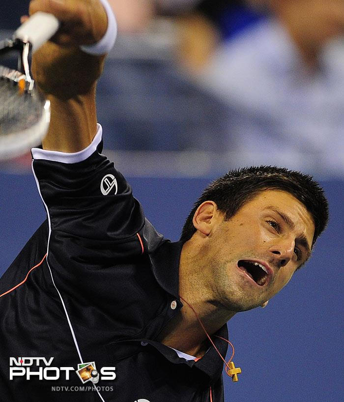 """<b>Qoute of the day: </b>""""This guy (Djokovic) is from another planet"""", summed up Carlos Berlocq's emotion after Djokovic overpowered him. (AFP Photo)"""