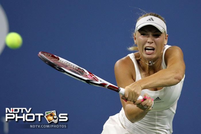 <b>Best seed in action(Women's): </b>She hasn't won a single Grand Slam in her career but continues to be the No.1 player in the World; Caroline Wozniacki defeated Arantxa Rus of Netherlands, 6-2, 6-0. (AFP Photo)