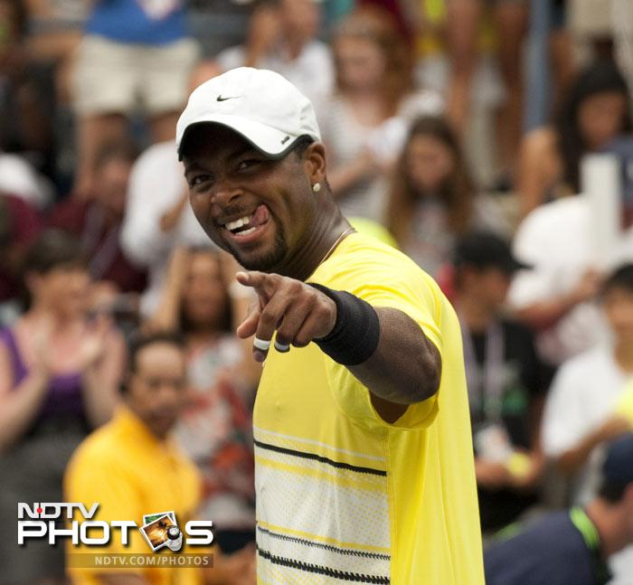 <b>Moment of joy: </b>Donald Young points to the crowd after winning his third round match against Juan Ignacio Chela of Argentina. (AFP Photo)