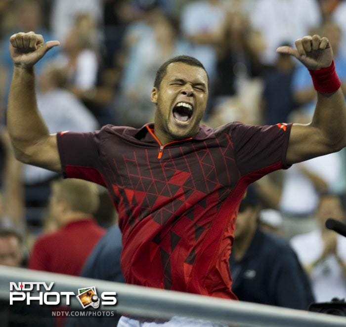<b>Moment of joy: </b>Jo-Wilfried Tsonga of France celebrates after beating American favourite Mardy Fish 6-4, 6-7 (5), 3-6, 6-4, 6-2. (AFP Photo)