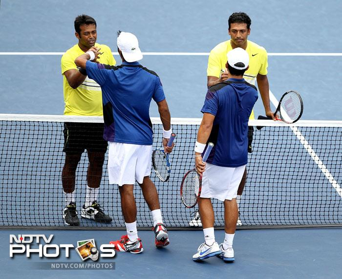 <b>Moment of the day: </b>It was the clash of the old and new tennis stars for India as the legendary pairing of Mahesh Bhupathi and Leander Paes ousted Somdev Devvarman's pairing with Treat Conrad Huey. (AFP Photo)