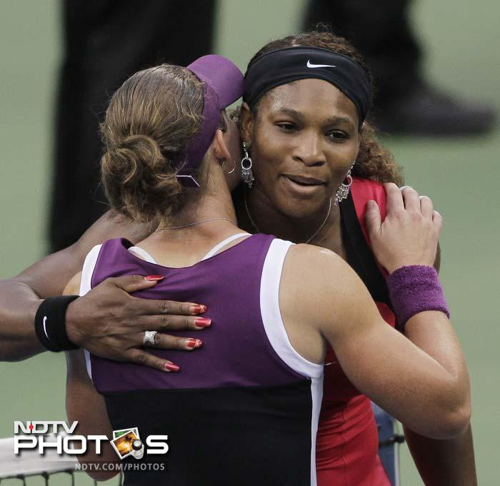 Serena Williams, right, hugs Samantha Stosur of Australia after the women's championship match at the U.S. Open. (AP Photo)