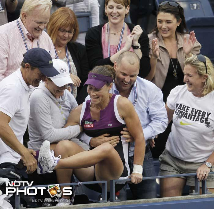 Samantha Stosur of Australia reacts with loved ones after winning the women's championship match against Serena Williams. (AP Photo)