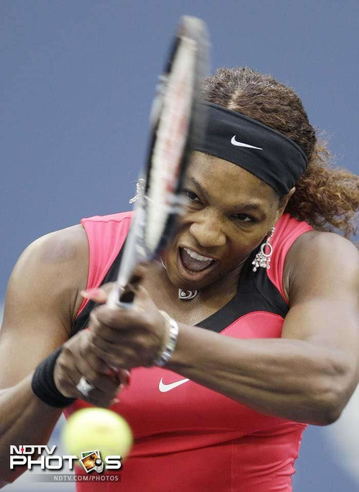 Serena Williams returns a shot to Samantha Stosur of Australia during the women's championship match at the U.S. Open. (AP Photo)