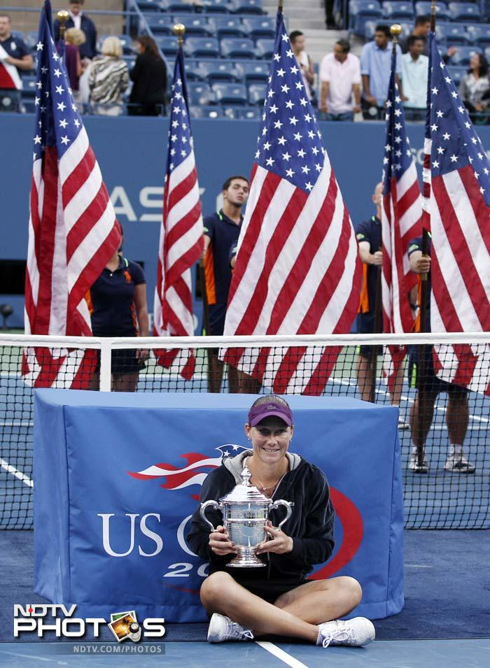 Samantha Stosur of Australia poses with the championship trophy after beating Serena Williams. (AP Photo)