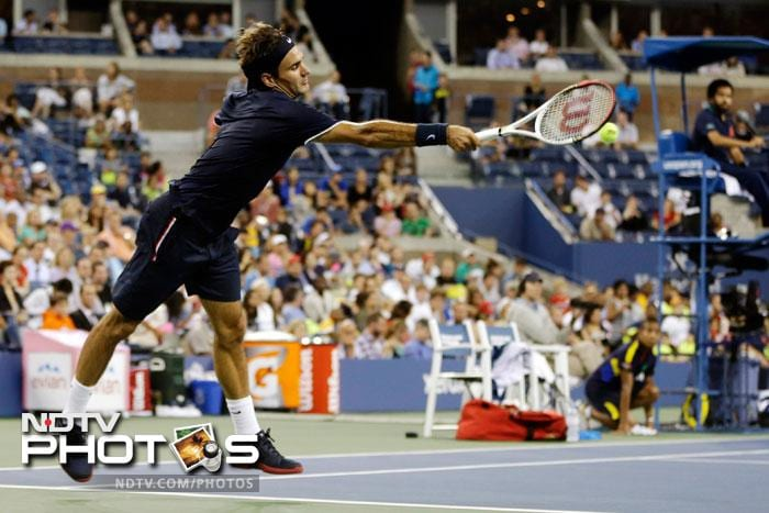 Roger Federer of Switzerland returns a shot to Donald Young during a match at the US Open in New York. Federer won 6-3, 6-2, 6-4. (AP Photo)