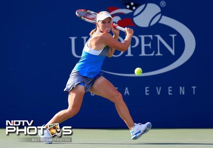 Melanie Oudin of the United States returns a shot during her women's singles first round match against Lucie Safarova of Czech Republic at the US Open in New York. (AFP Photo)