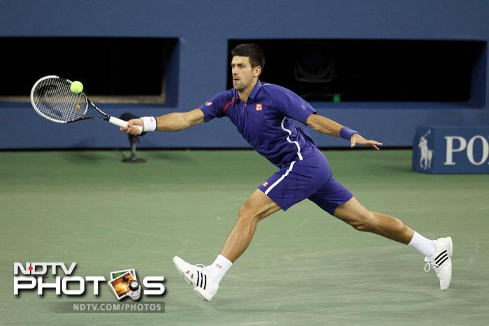 Novak Djokovic returns a shot during his men's singles final match of the 2012 US Open against Andy Murray at USTA Billie Jean King National Tennis Center in the Flushing neighborhood of the Queens borough of New York City. (AFP Photo)