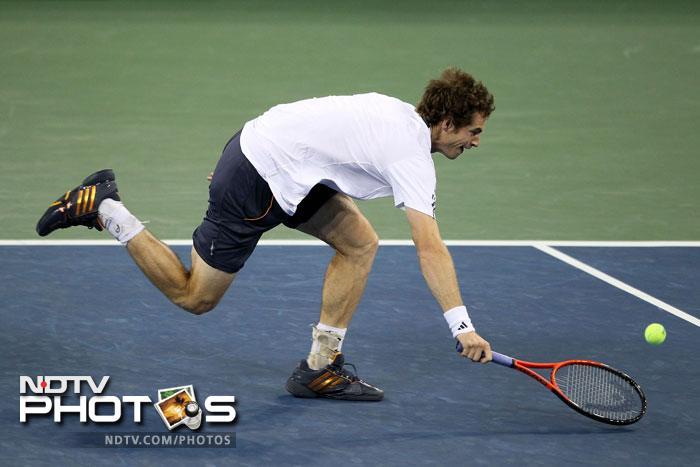 Andy Murray returns a shot during his men's singles final match against Novak Djokovic. (AFP Photo)