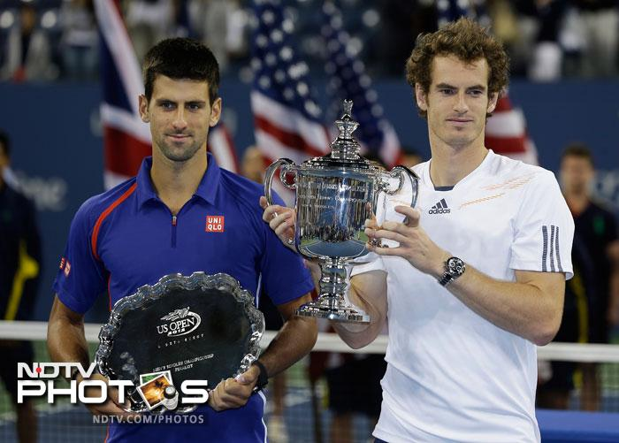 Andy Murray poses with Novak Djokovic after the championship match at the 2012 US Open tennis tournament. (AP Photo)