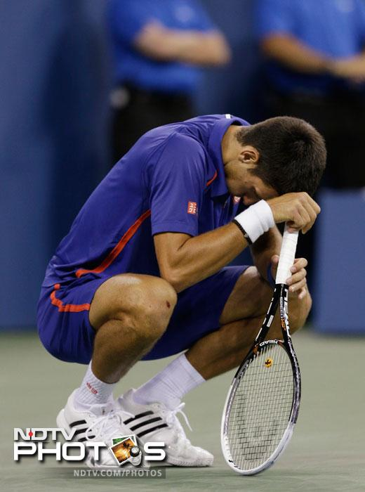 Novak Djokovic reacts while playing Andy Murray during the championship match at the 2012 US Open tennis tournament in New York. (AP Photo)