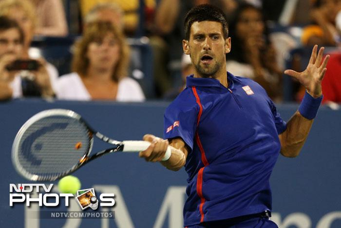 Novak Djokovic returns a shot during his men's singles fourth round match against Stanislas Wawrinka on Day Nine of the 2012 US Open at USTA Billie Jean King National Tennis Center in New York. (AFP Photo)