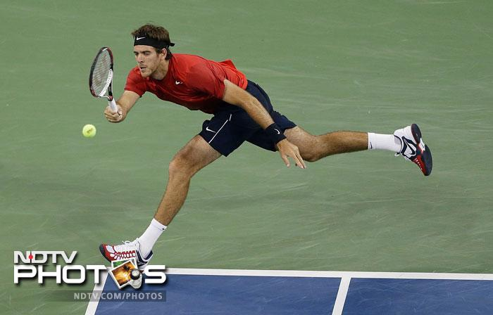 Juan Martin Del Potro returns a shot to Andy Roddick in the fourth round of play at the 2012 US Open tennis tournament in New York. (AP Photo)