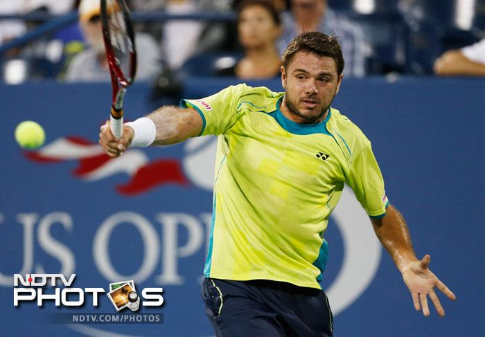 Stanislas Wawrinka returns a shot to Novak Djokovic in the fourth round of play at the 2012 US Open tennis tournament in New York. (AP Photo)