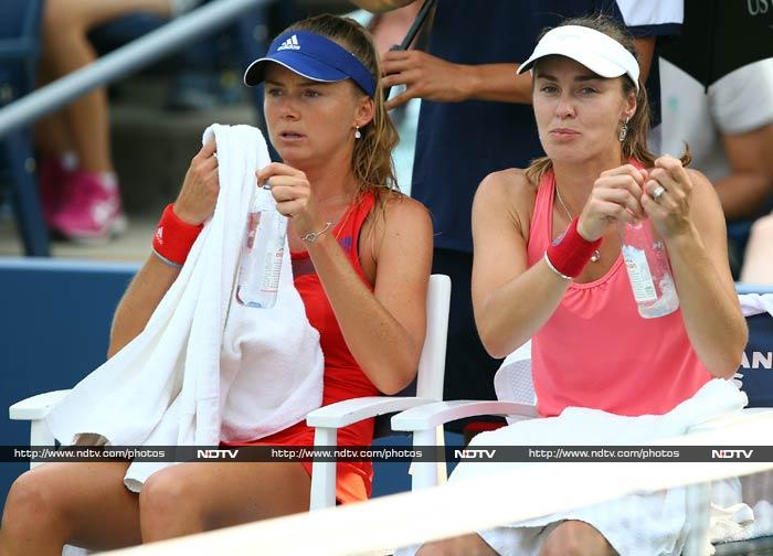 Former world number one Martina Hingis had her Grand Slam comeback after six years of retirement cut short on Friday with two doubles defeats. <br> Hingis and Slovakian partner Daniela Hantuchova lost to Italian top-seeded defending champions Sara Errani and Roberta Vinci 6-3, 7-5 in women's doubles, with Hingis double faulting away the final points.<br> In a later match, Sweden's Robert Lindstedt and Taiwan's Chan Yung-Jan beat wildcard entrants Hingis and India's Mahesh Bhupathi 7-6 (7/5), 7-6 (7/5) in mixed doubles.