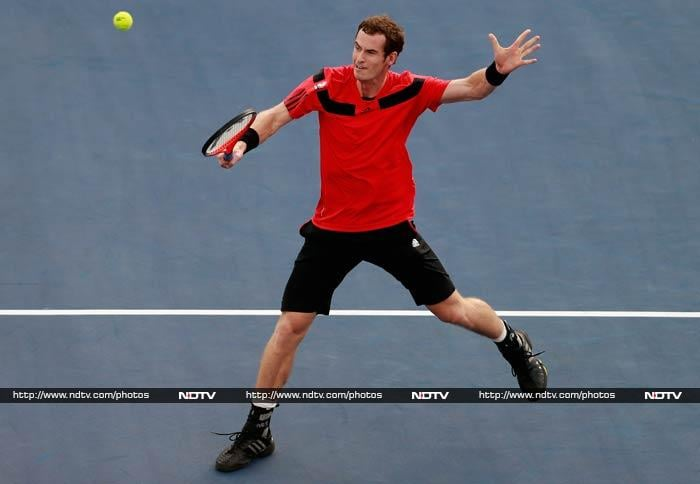 British third seed Andy Murray, the reigning Wimbledon and Olympic champion, advanced with a 7-5, 6-1, 3-6, 6-1 victory over Argentina's 81st-ranked Leonardo Mayer in a match of rivals who were both born on May 15, 1987.