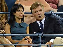 US Actor Alec Baldwin and his wife Hilaria Thomas watch Belgium's Kim Clijsters play against US Victoria Duval.