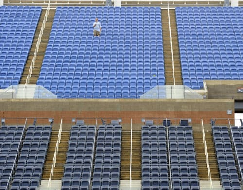 Fan stands alone in the stands as rain delays the start of the women's semifinals US Open match at the USTA Billie Jean King National Tennis Center in New York. (AFP Photo)