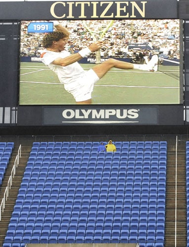The 1991 famous five-setter between US tennis players Jimmy Connors (on screen) and Aaron Krickstein is shown as rain delays the start of the women's US Open semifinals at the USTA Billie Jean King National Tennis Center on in New York. (AFP Photo)