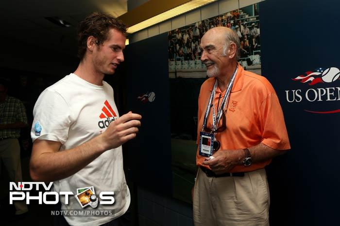 A news conference after the match had another surprise for Murray when veteran actor Sean Connery 'crashed in'. The two are seen here having a conversation.