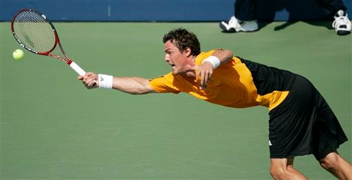 Marat Safin of Russia lunges out to hit a serve from Frank Dancevic of Canada at the US Open tennis tournament in New York on Wednesday.