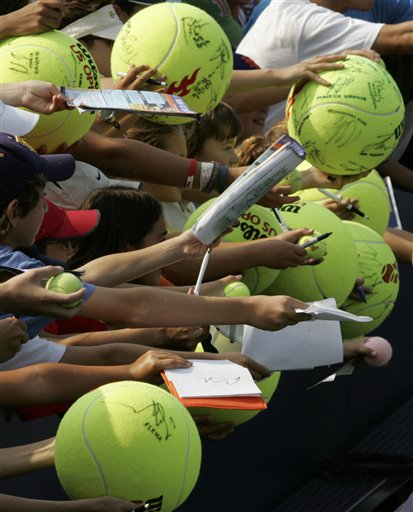 Spectators wait to get autographs at the Louis Armstrong Stadium at the US Open tennis tournament in New York on Thursday.