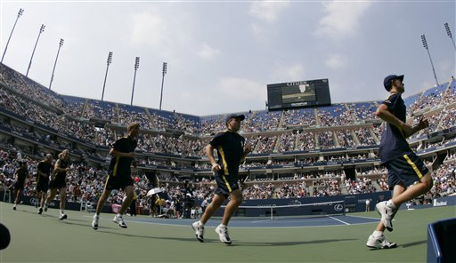 Ball runners take to the court in Arthur Ashe Stadium before the start of the match between Andy Roddick of the United States and Jose Acasuso of Argentina the at the US Open tennis tournament in New York on Thursday.