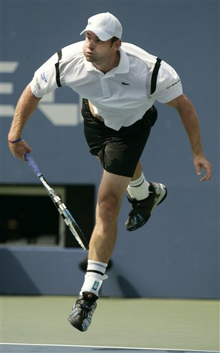 Andy Roddick of the United States follows through on his serve to Jose Acasuso of Argentina at the US Open tennis tournament in New York on Thursday.