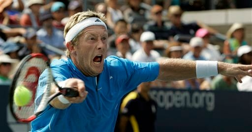 Jonas Bjorkman of Sweden returns a volley to Andy Murray of Britain at the US Open tennis tournament in New York on Thursday.