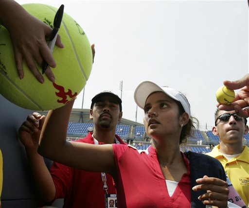 Sania Mirza of India signs autographs after defeating Laura Granville of the United States at the US Open tennis tournament in New York on Thursday.