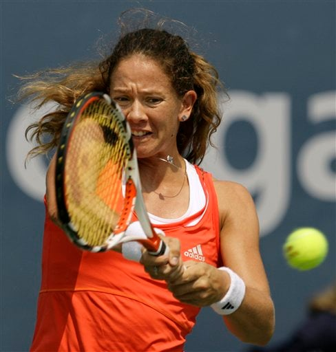 Patty Schnyder of Switzerland returns a volley to Severine Bremond of France at the US Open tennis tournament in New York on Thursday.