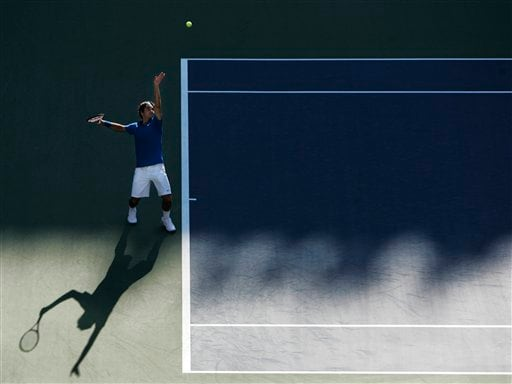 Roger Federer of Switzerland serves to John Isner of the United States at the US Open tennis tournament in New York on Saturday.