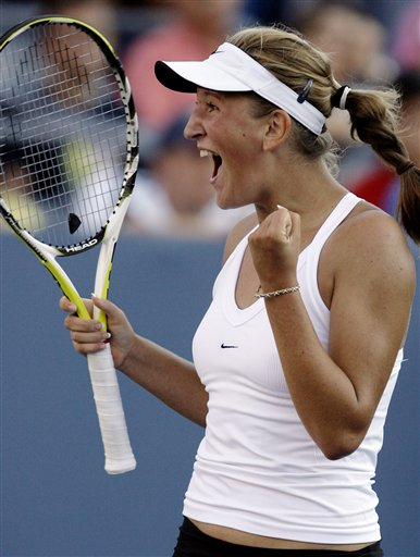 Victoria Azarenka of Belarus celebrates her victory over Martina Hingis of Switzerland after their match at the US Open tennis tournament in New York on Saturday.