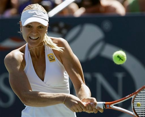 Agnes Szavay of Hungary backhands a shot to Nadia Petrova of Russia at the US Open tennis tournament in New York on Saturday.