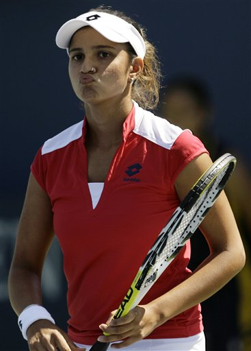 Sania Mirza of India grimaces during her match against Anna Chakvetadze of Russia at the US Open tennis tournament in New York on Saturday.