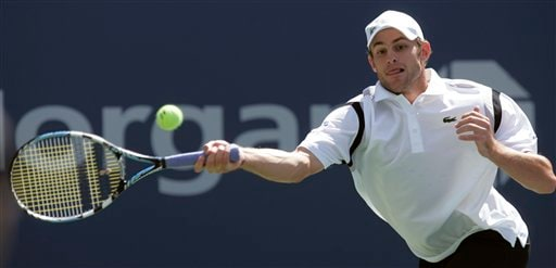 Andy Roddick of the United States returns a shot to Thomas Johansson of Sweden at the US Open tennis tournament in New York on Saturday.