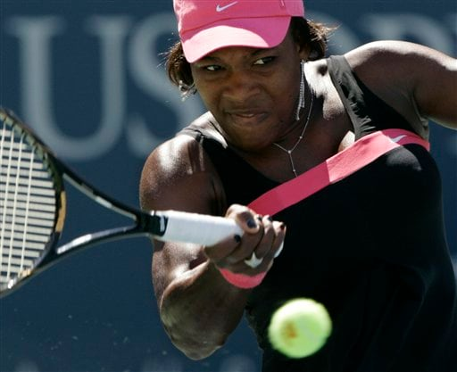 Serena Williams of the United States returns a volley to Marion Bartoli of France during their match at the US Open tennis tournament in New York on Sunday.