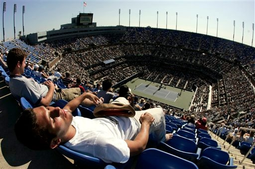 Francisco Ugalde from New York rests during a between Venus Williams of the United States and Ana Ivanovic of Serbia in the Arthur Ashe Stadium at the US Open tennis tournament in New York on Sunday.