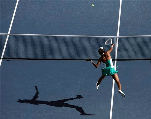 Venus Williams of the United States charges the net to return a shot to Ana Ivanovic of Serbia in the Arthur Ashe Stadium at the US Open tennis tournament in New York on Sunday.
