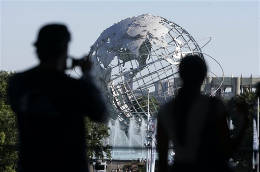 Spectators at the US Open tennis tournament take photos of Unisphere in New York on Sunday.
