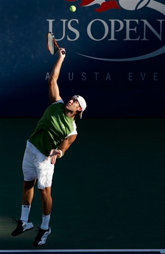 Robby Ginepri of the U.S. serves to Stanislas Wawrinka of Switzerland at the US Open tennis tournament in New York on Sunday.